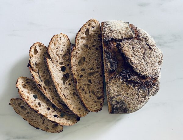 Sourdough Bread, half cut to expose crumb and crust thickness