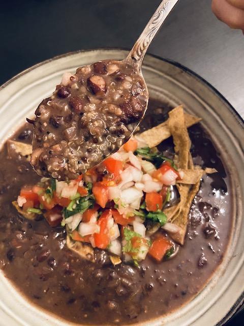 Vegan Mexican inspired black bean bean soup with fresh Pico de Gallo